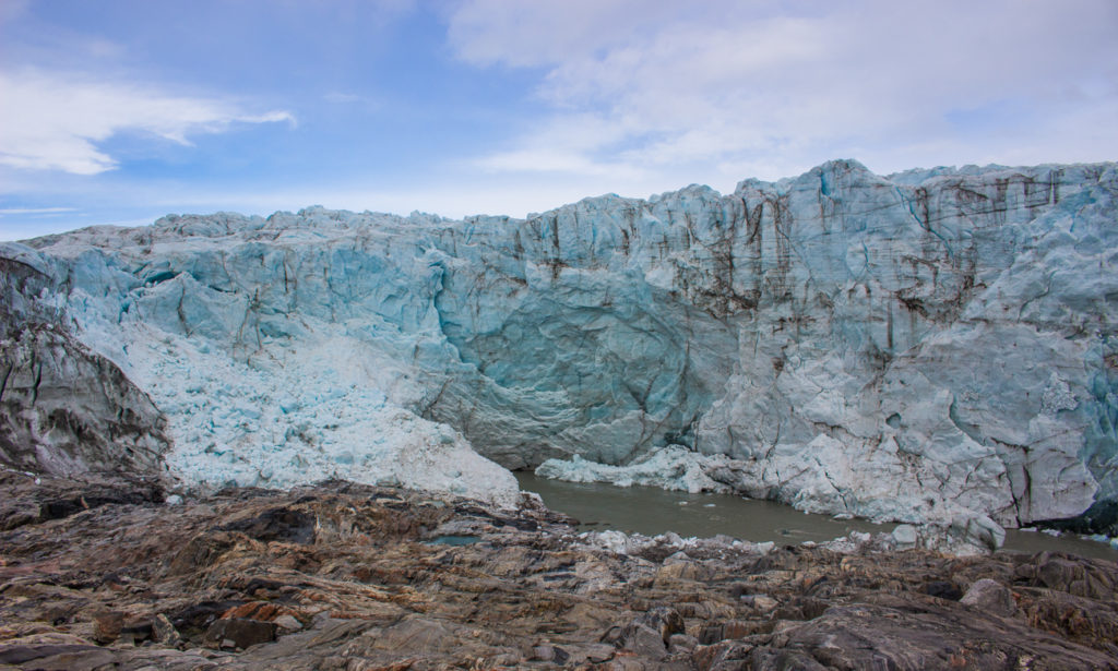 The face of russel glacier and river flowing underneath