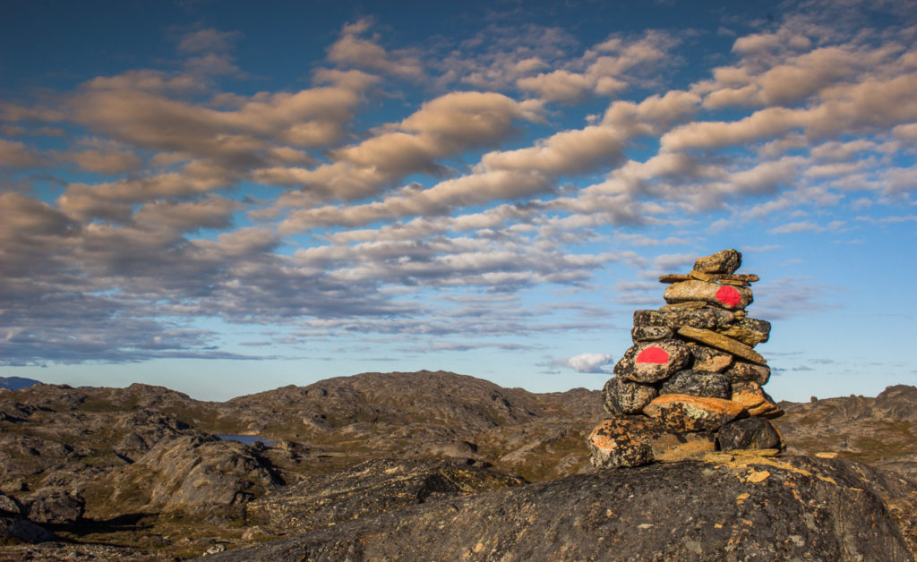 Cairn on Arctic circle trail in stony surface