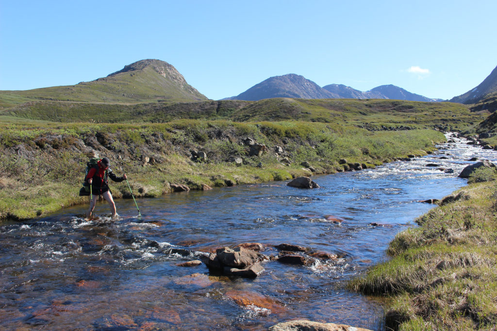 A gury crossing the river on Arctic circle trail