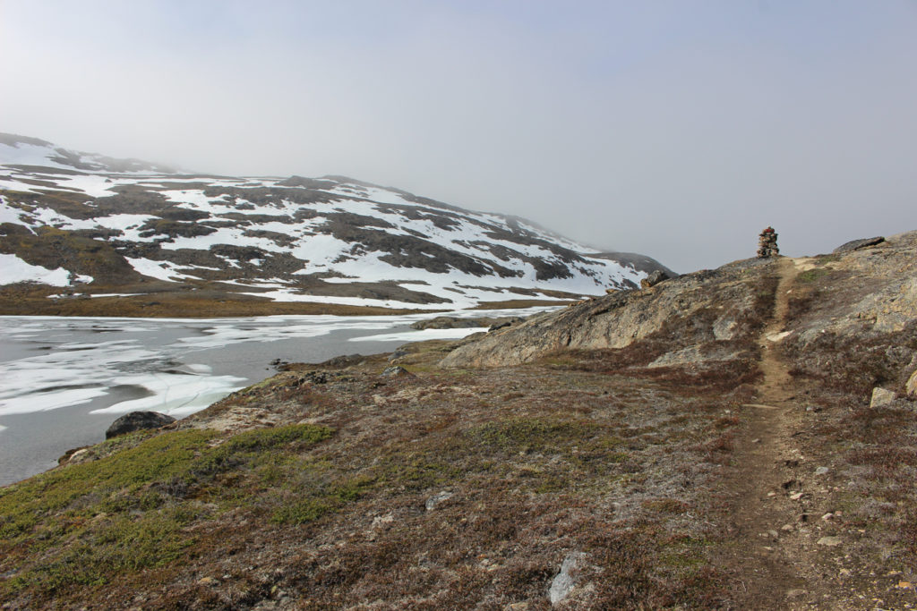 the path to Sisimiut with a snowy mountain around