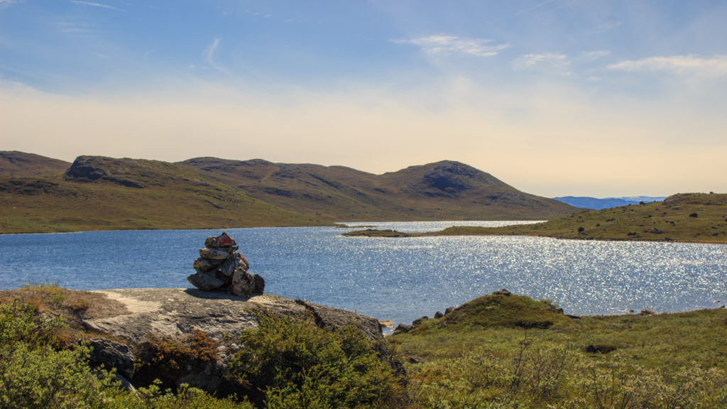 Lake and landscape with cairn