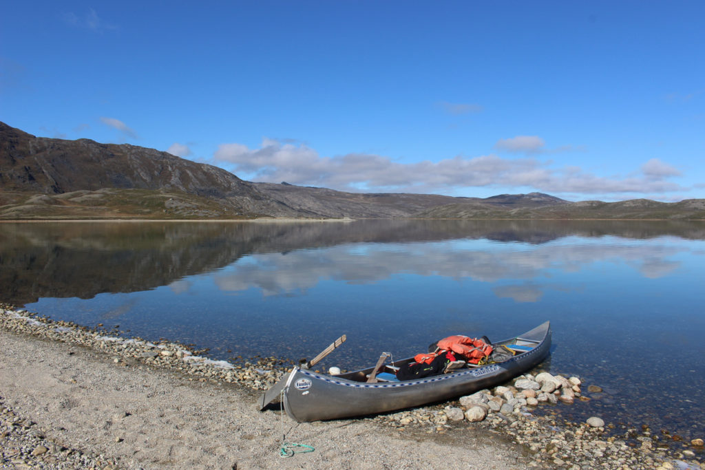 Arctic circle trail canoe on the shore of the lake