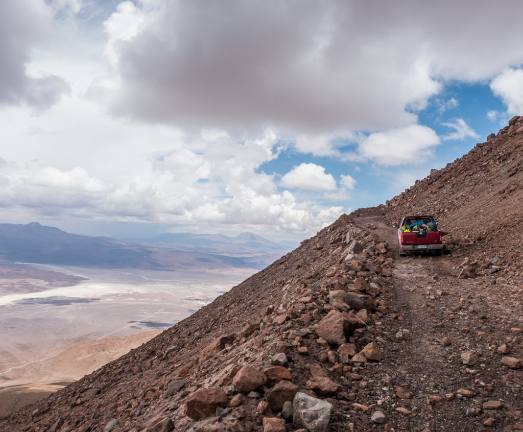 4WD car driving up the steep volcano