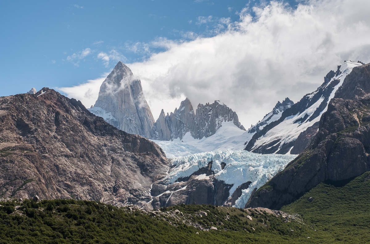 Fitz Roy mountain on El Chalten circuit with glacier Piedras blancas flowing down the valley