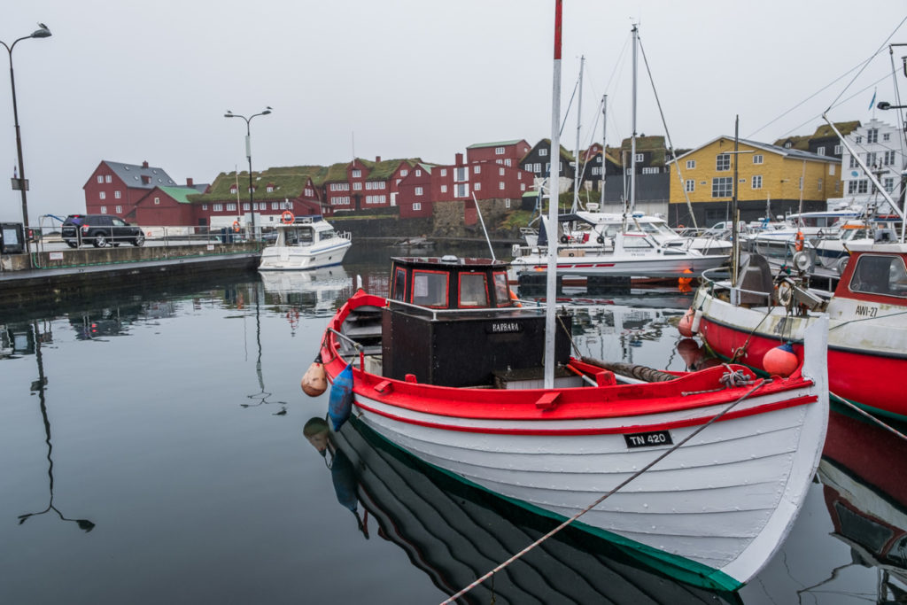 Torshavn port with the parliament houses and parked boats