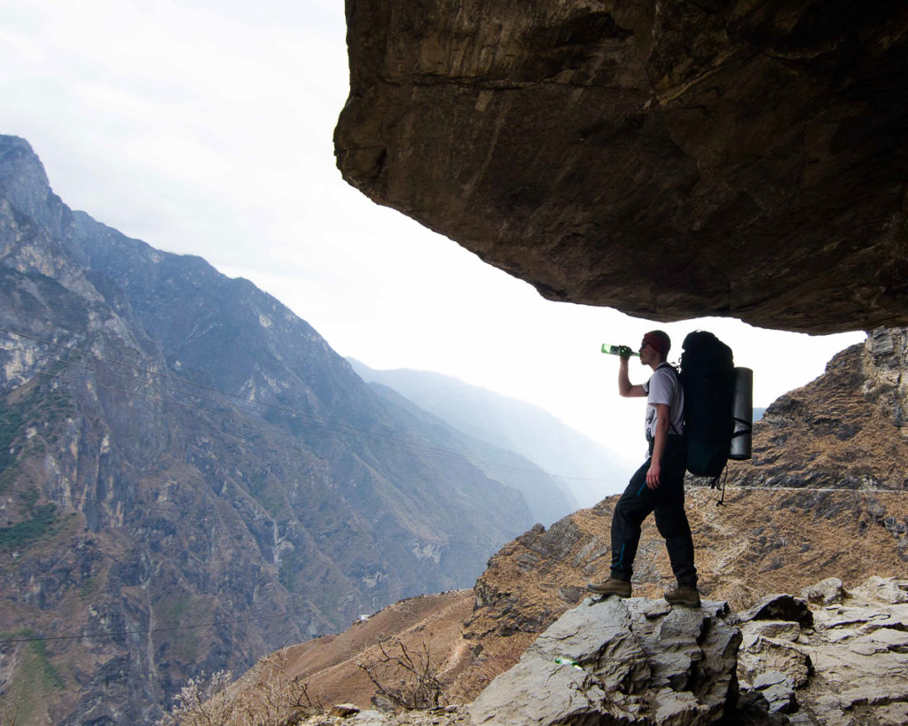 A guy drinking a beer on a Tiger leaping gorge trek