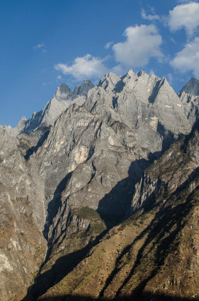 Steep rocky face of the Snow mountain falling down to tiger leaping gorge