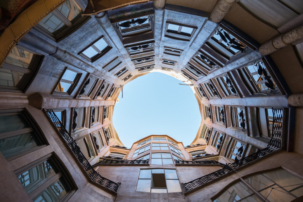 looking up the porch in famous Casa Mila in Barcelona