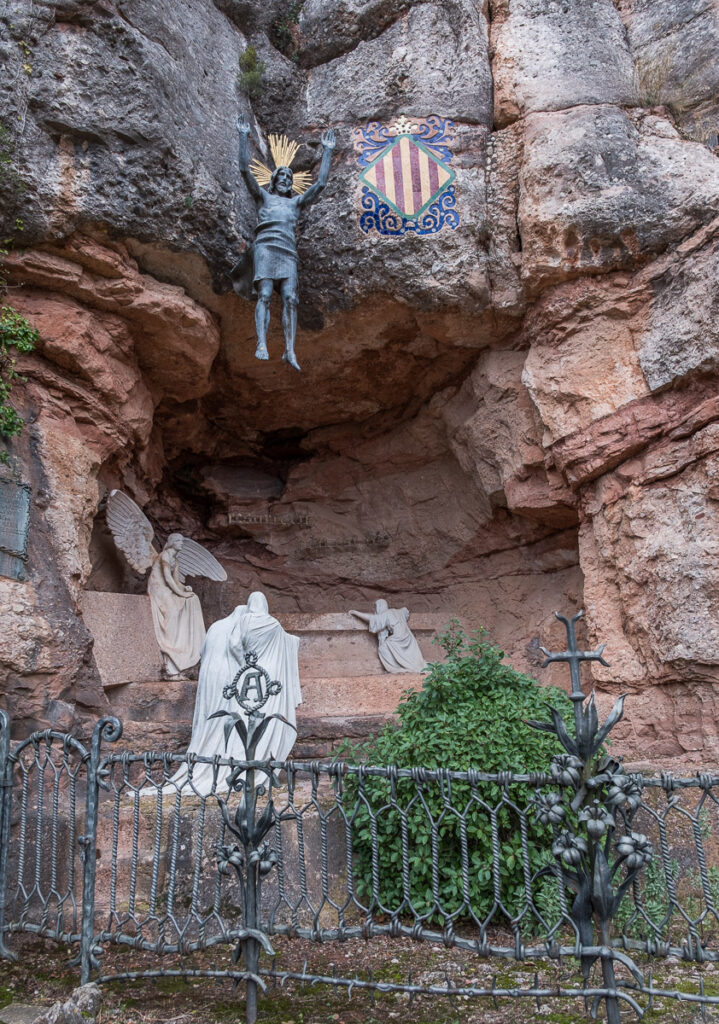 Statues at Montserrat in the rock made by Gaudi