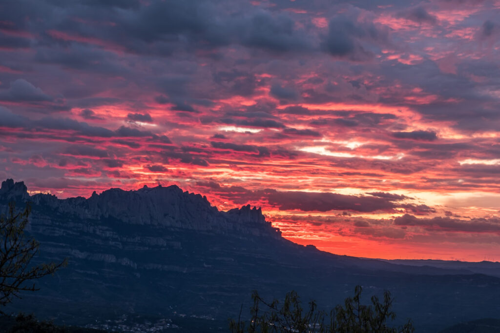 Sunset ovet the ridge of montsrrat with red clouds