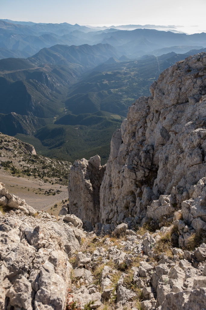 View from the main summit Polegó Inferior towards the rugged Pyrenees