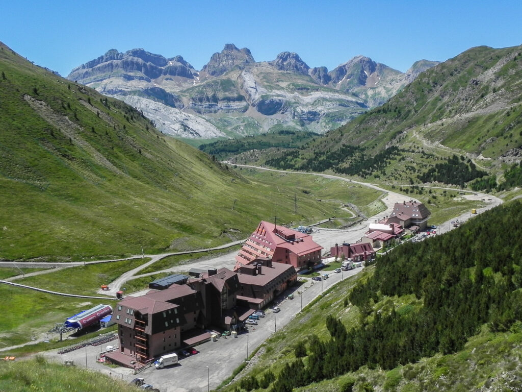 Pyrenean hotel of skiing centre with mountains in background