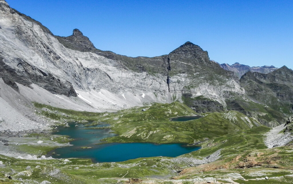 blue rugged lakes in the middle of the grassfield in mountains