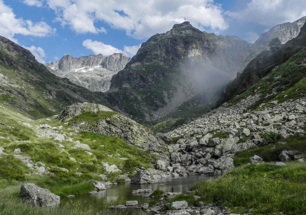 misty mountain with green grass in forehead on Pyrenean Haute Route