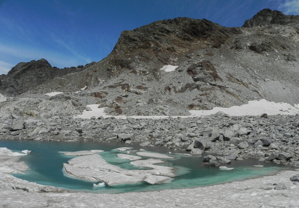 icebergs in the lake under the rosky mountain