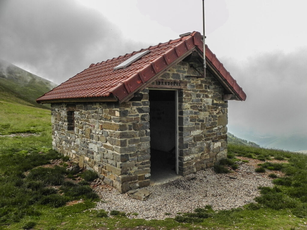 Small stone house on the top of the hill for overnighting of trekkers