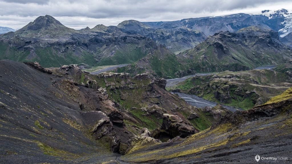 Thorsmork valley with mossy rocks and snowy mountains of Iceland with galciers in background