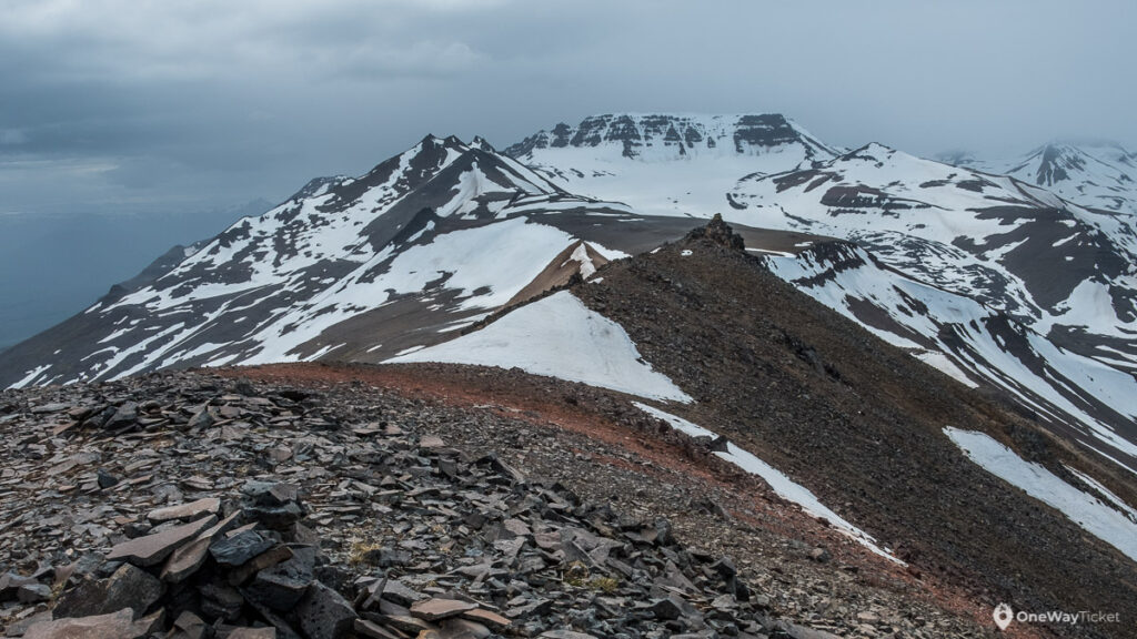 the pass on Fimmvorduhals Hike in height of 1170 meteres with snowy peaks and rocky sections in Iceland