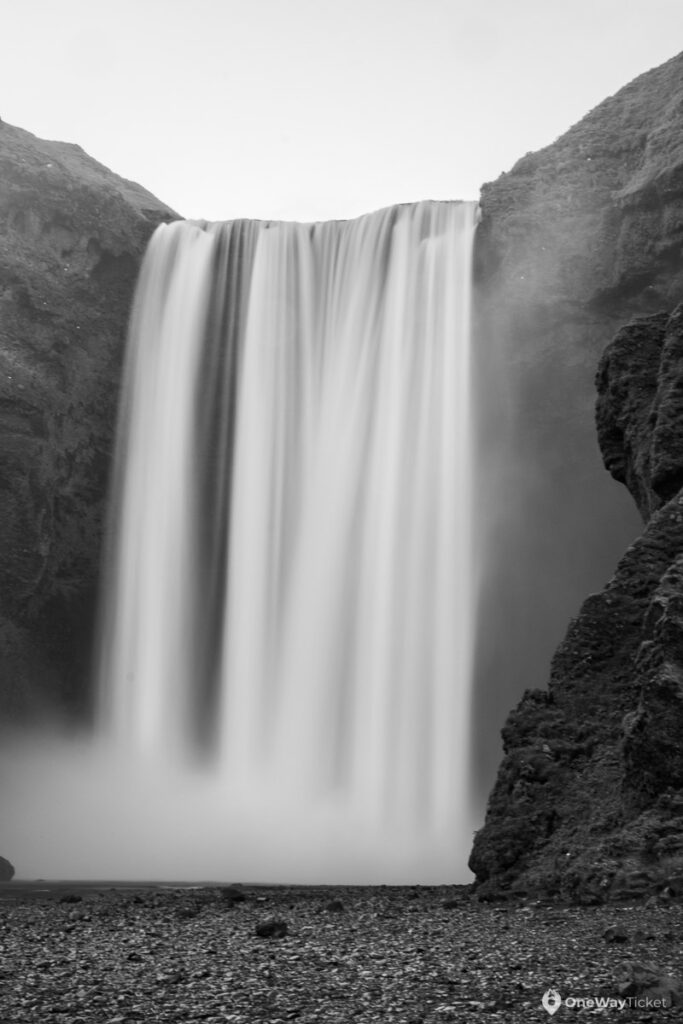 The famous waterfall Skogafoss in Iceland dropping 60 meters from the cliff in black and white
