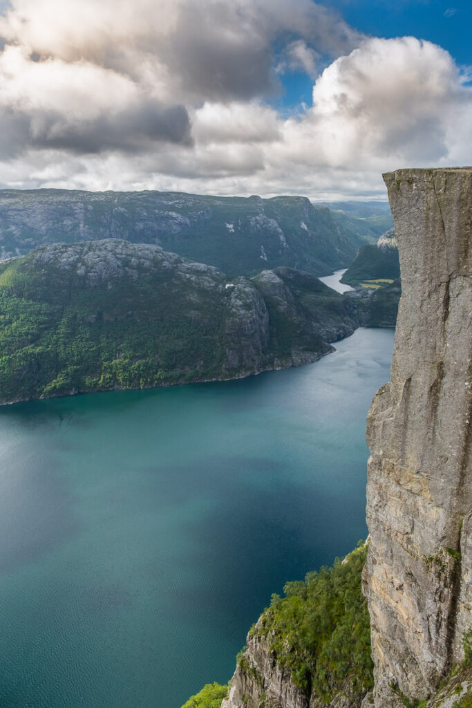 Incredibly high cliff Pulpit Rock falling down to the sea in Norway