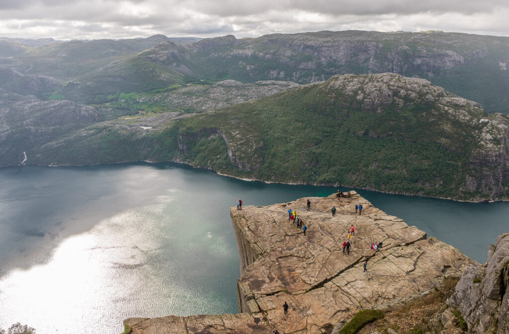 Huge rock block named Pulpit rock falling down to the fjord in north europe with dark clouds in background