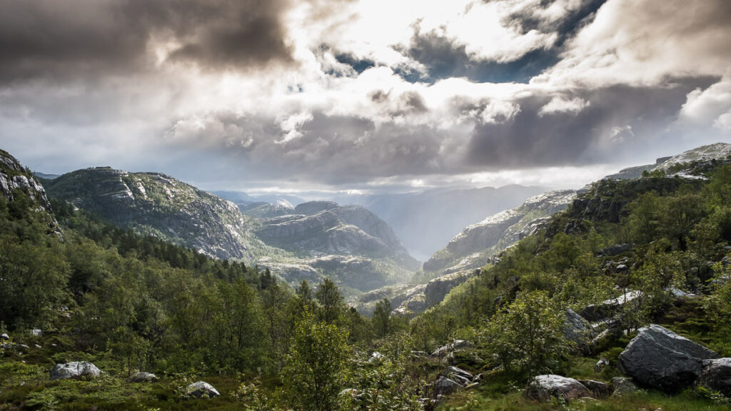 Clouds flowing above the nordic nature on the way to Pulpit rock in Norway