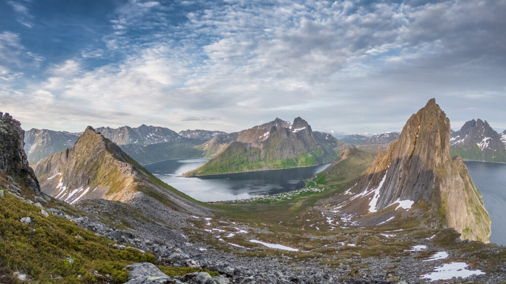 Breath taking view of the small scandinavian village at the fjord with a big spikey mountain from hike to Segla