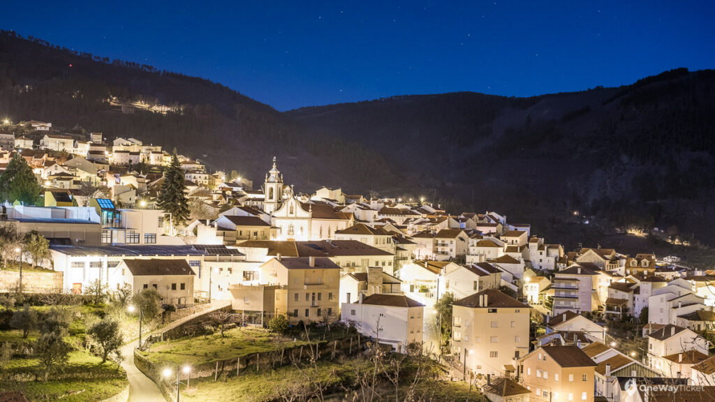 Manteigas town at night in the valley with stars in the sky