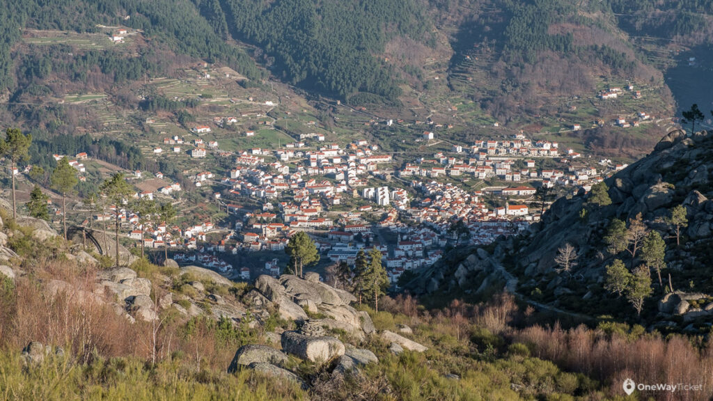 view of town Manteigas from the high peak with stones in between