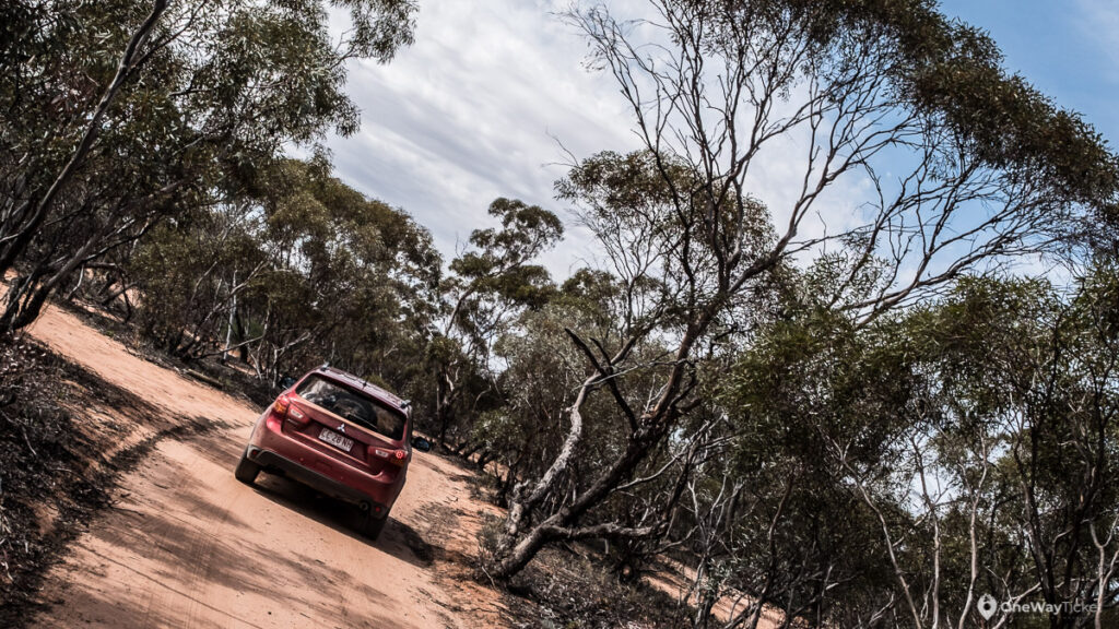 4WD car driving in the Mungo track in Australian outback