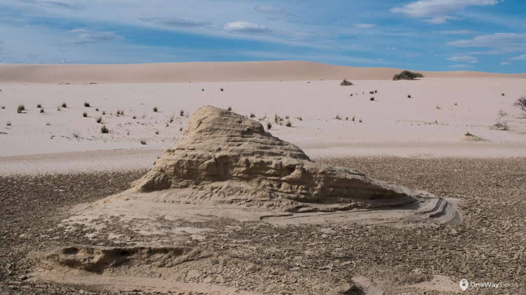 erroded sand stone with a dunes behind