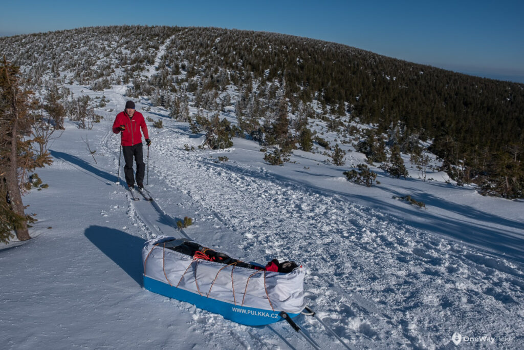 Man on skis in the nordicnature covered by snow on expedition with the pulk