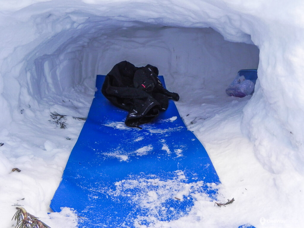 Snow cave made for sleeping with mattress inside